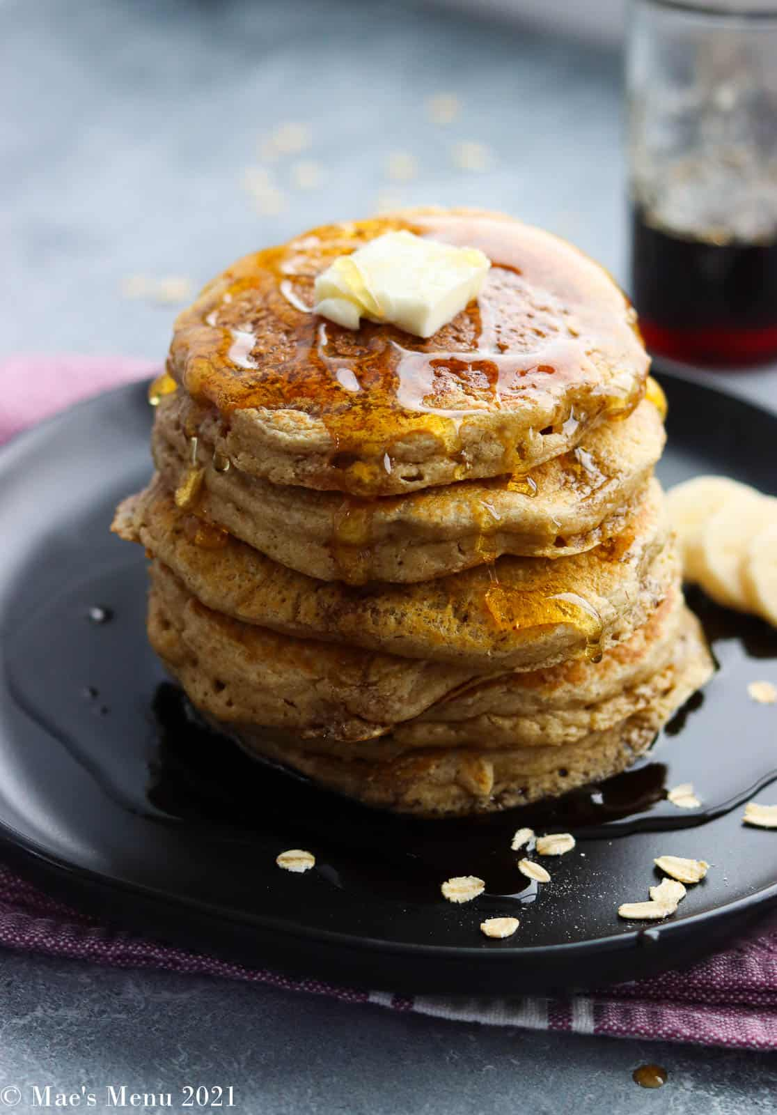 An overhead shot of a stack of oatmeal blender pancakes