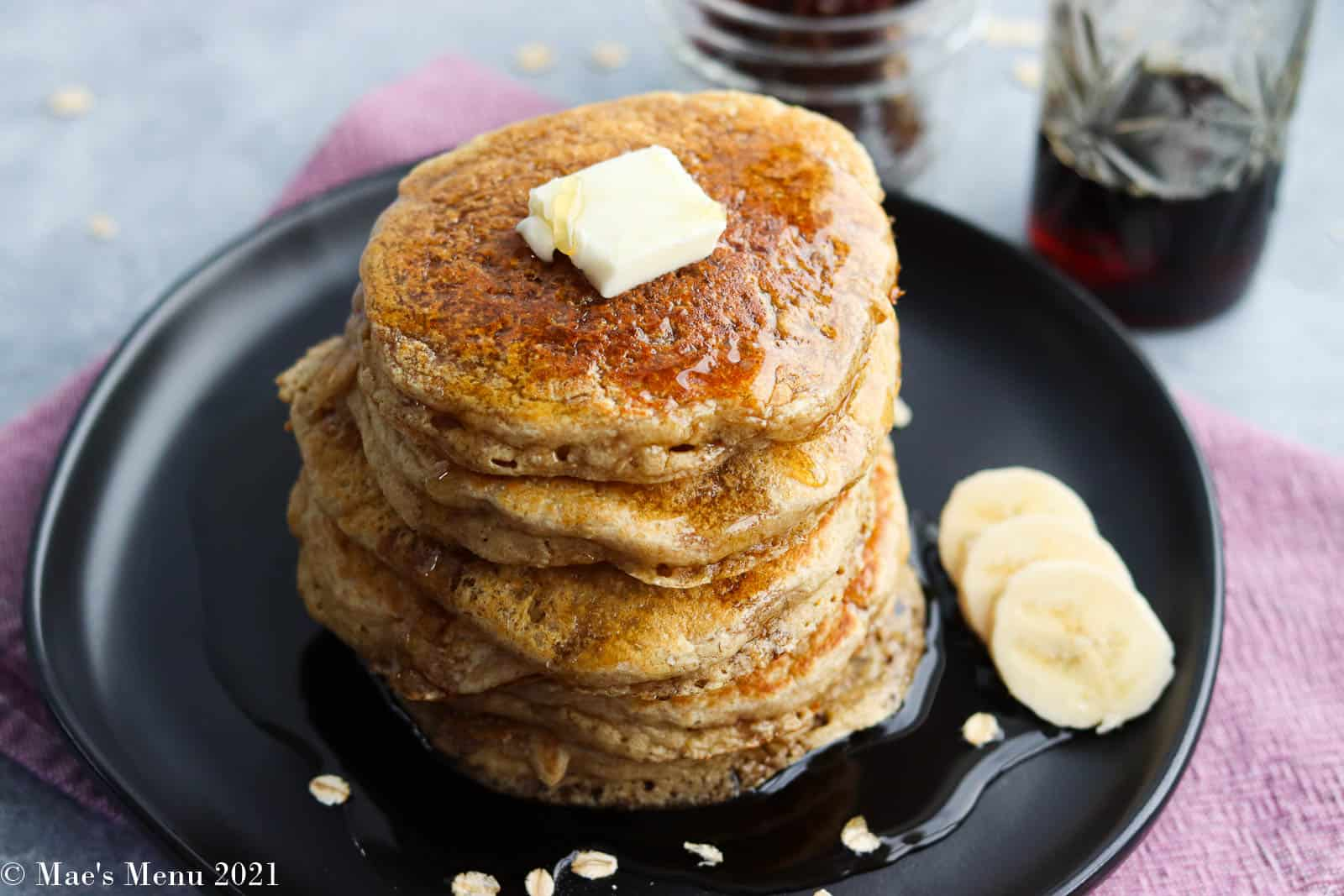 An overhead shot of the stack of pancakes on a plate
