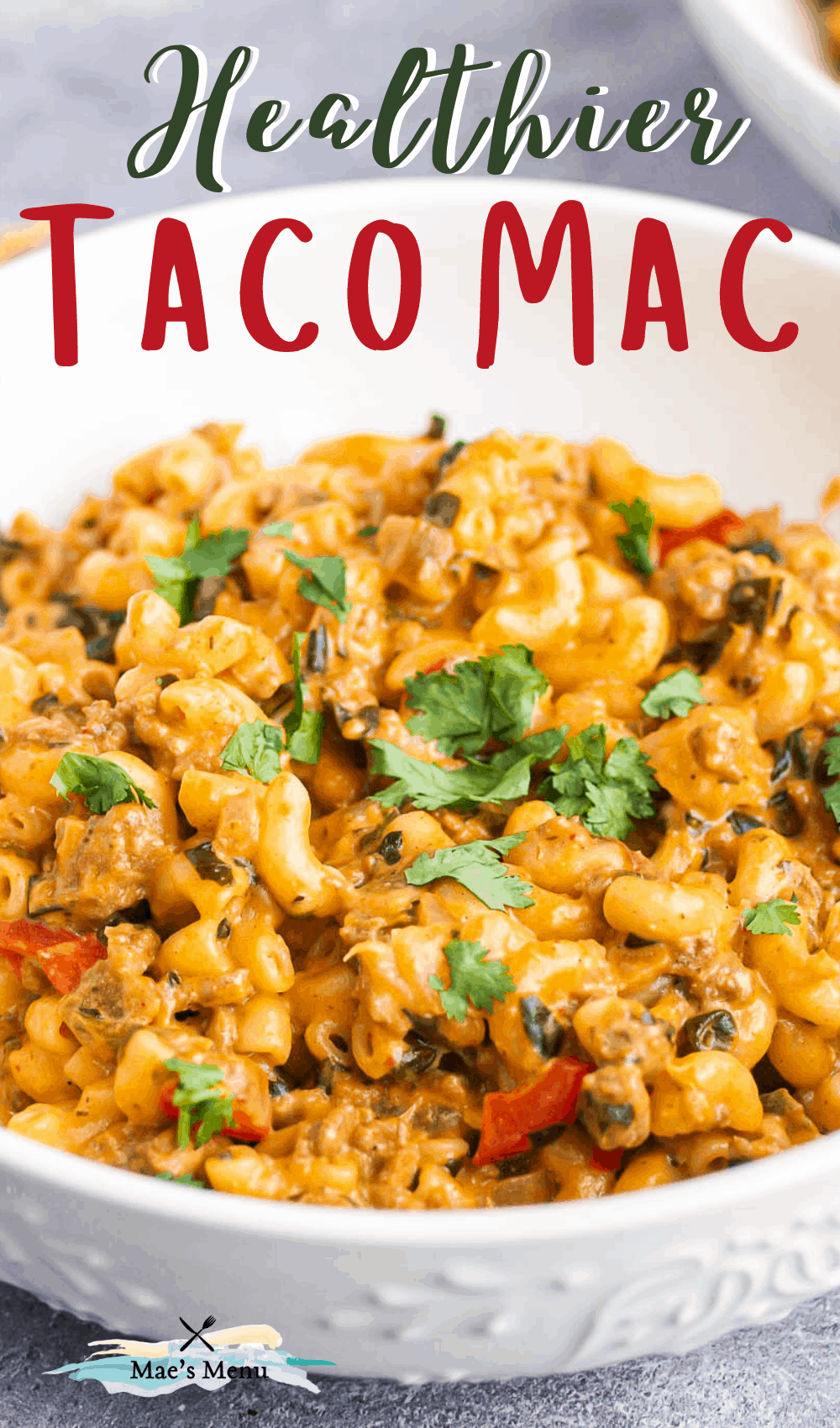 A pinterest pin for healthier taco mac and cheese with a side shot of a bowl of the recipe!