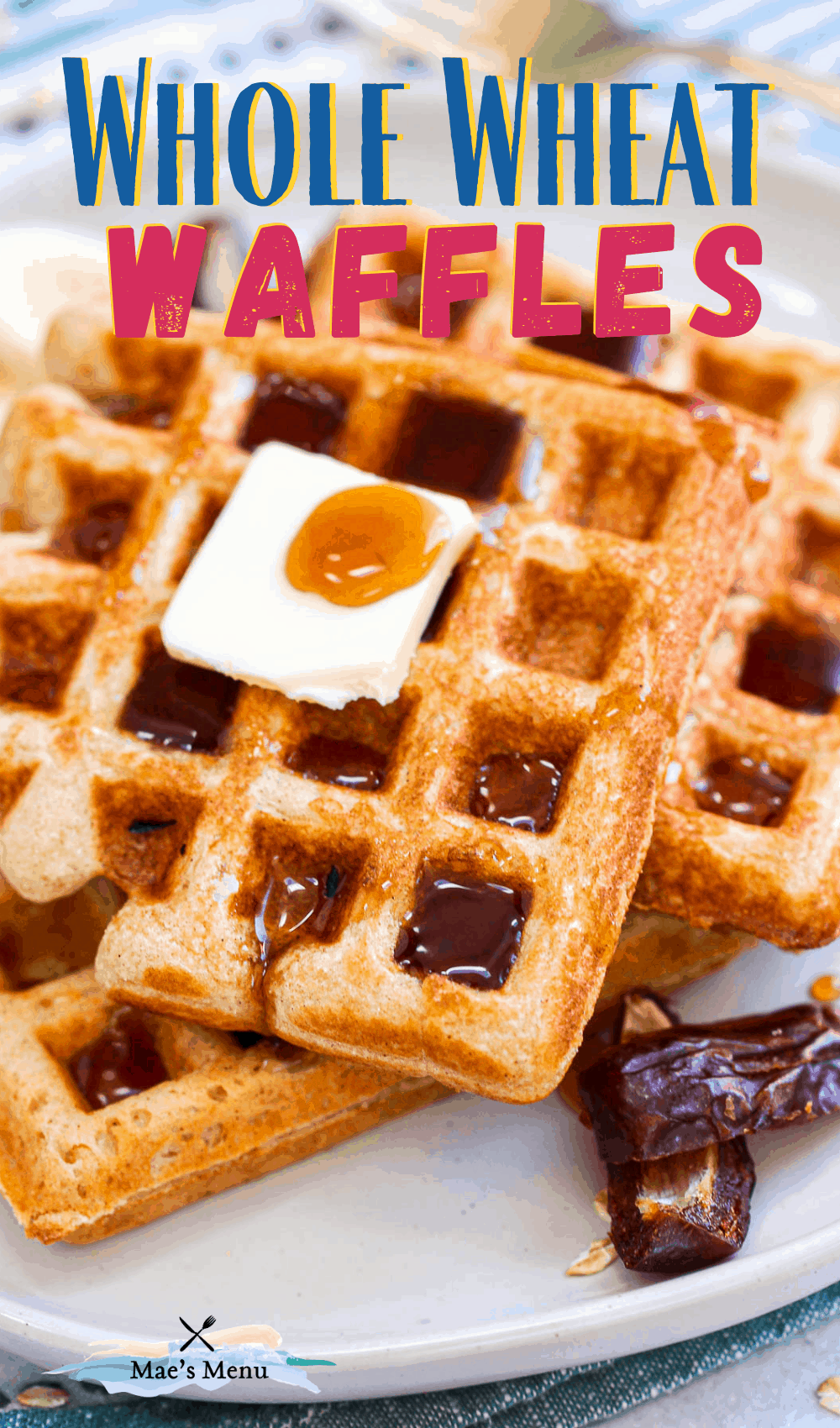 An angled up-close side shot of whole wheat belgian waffles on a white plate next to sliced dates