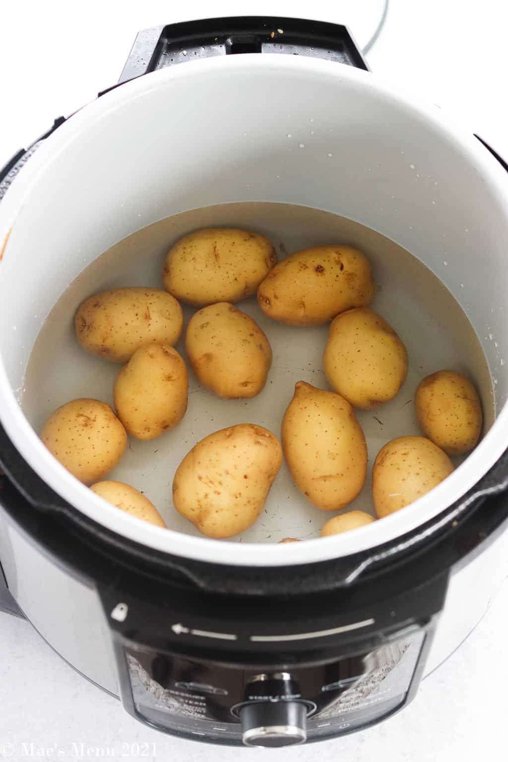 A pressure cooker full of baby golden potatoes