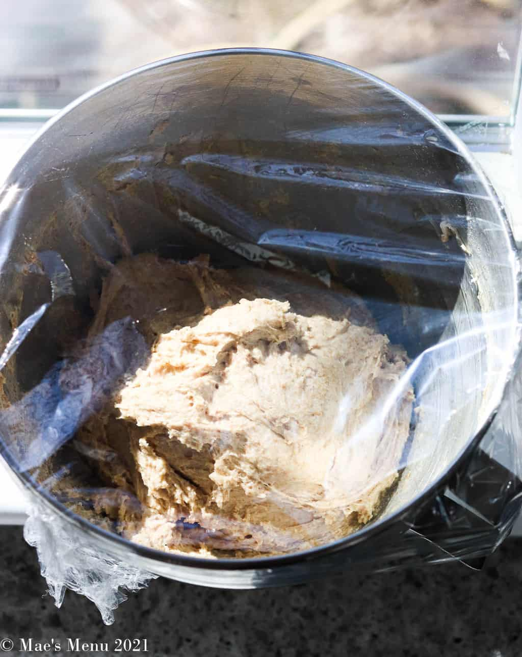 An overhead shot of bread leavening in a bowl