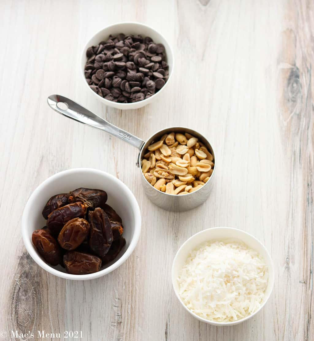 All  the ingredients for the date energy balls: dates, peanuts, shredded coconuts, and chocolate chips