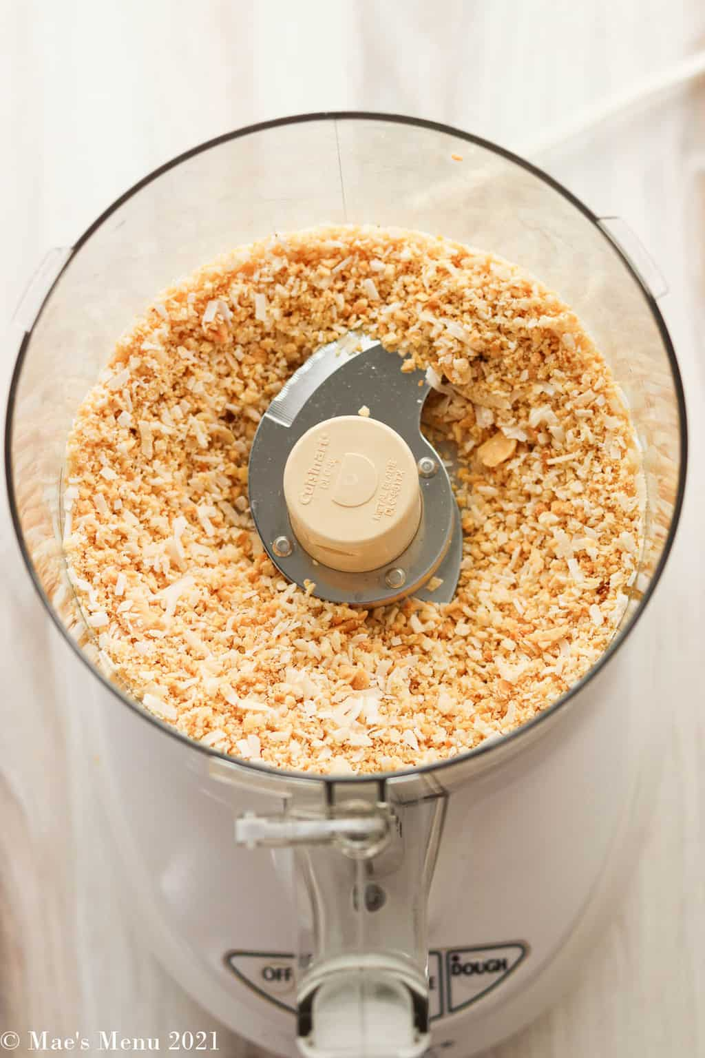 pulverized peanuts and dried coconut in a food processor