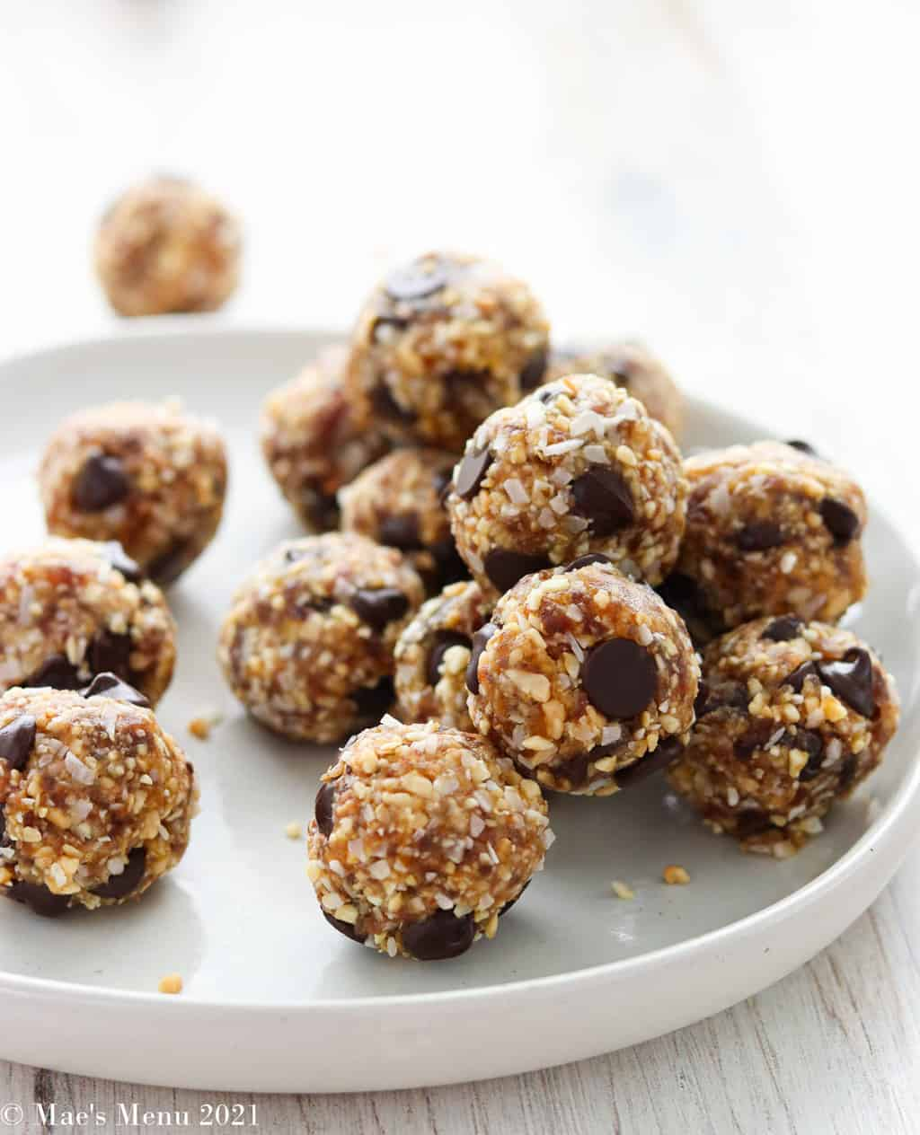A pile of date energy balls on a white plate
