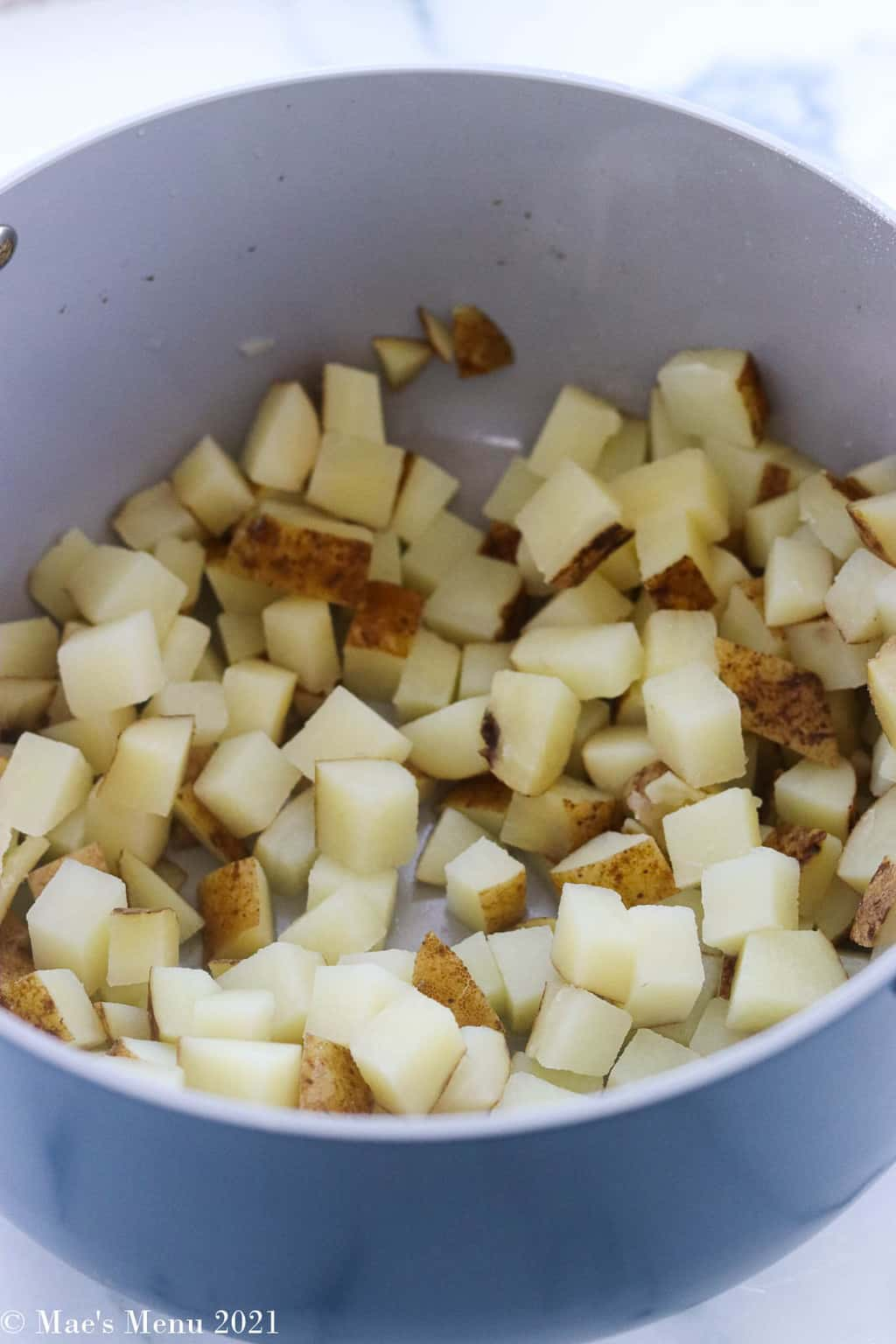 Simmered and drained potatoes in a stockpot