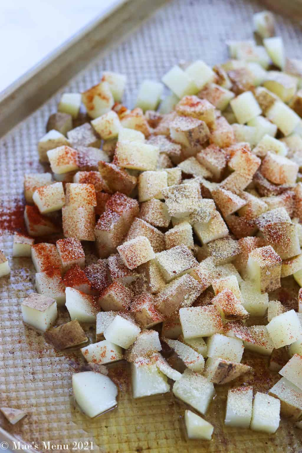 Potatoes on a baking sheet with the seasoning blend