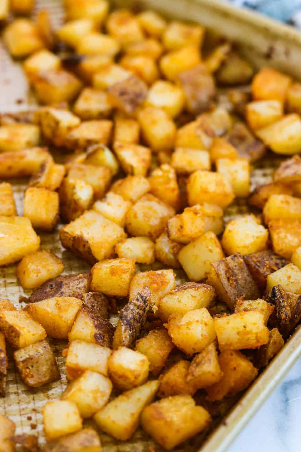 An up-close shot of a pan of roasted breakfast potatoes