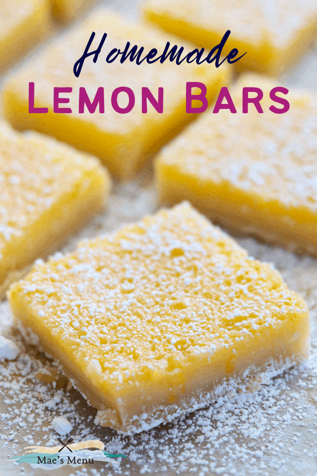 A pinterest pin for lemon bars with an up close photo of the bars  on the sheet of parchment paper