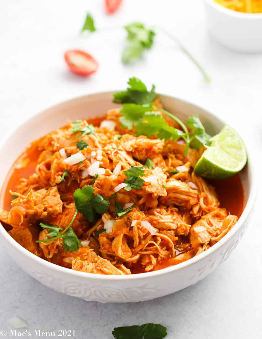 An overhead shot of a large bowl of instant pot shredded chicken tacos