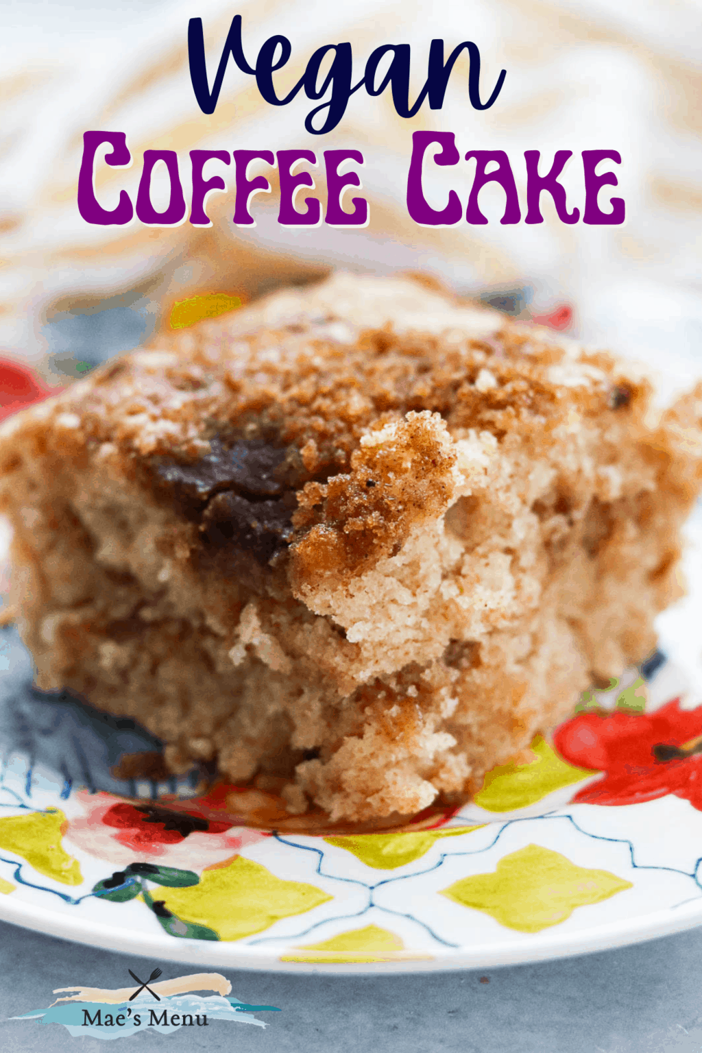 A pinterest pin for vegan coffee cake with an up-close shot of a piece on a plate