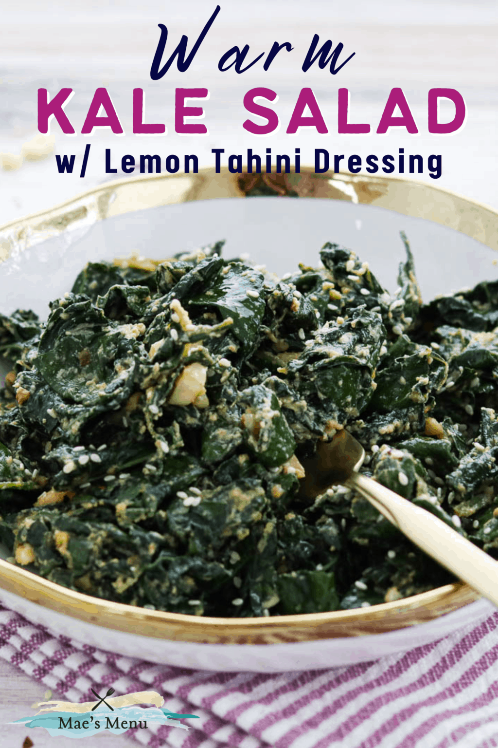A pinterest pin for warm kale salad with lemon tahini salad dressing. on the image is an upclose shot of the salad in a bowl