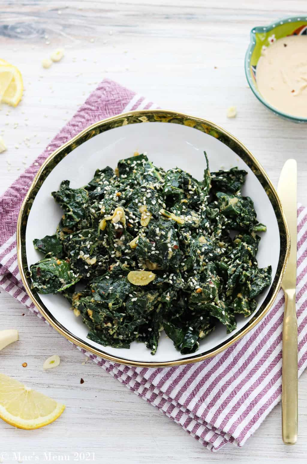 An overhead shot of a bowl of warm kale salad