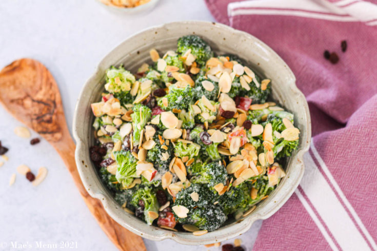 An overhead shot of a bowl of broccoli raisin salad