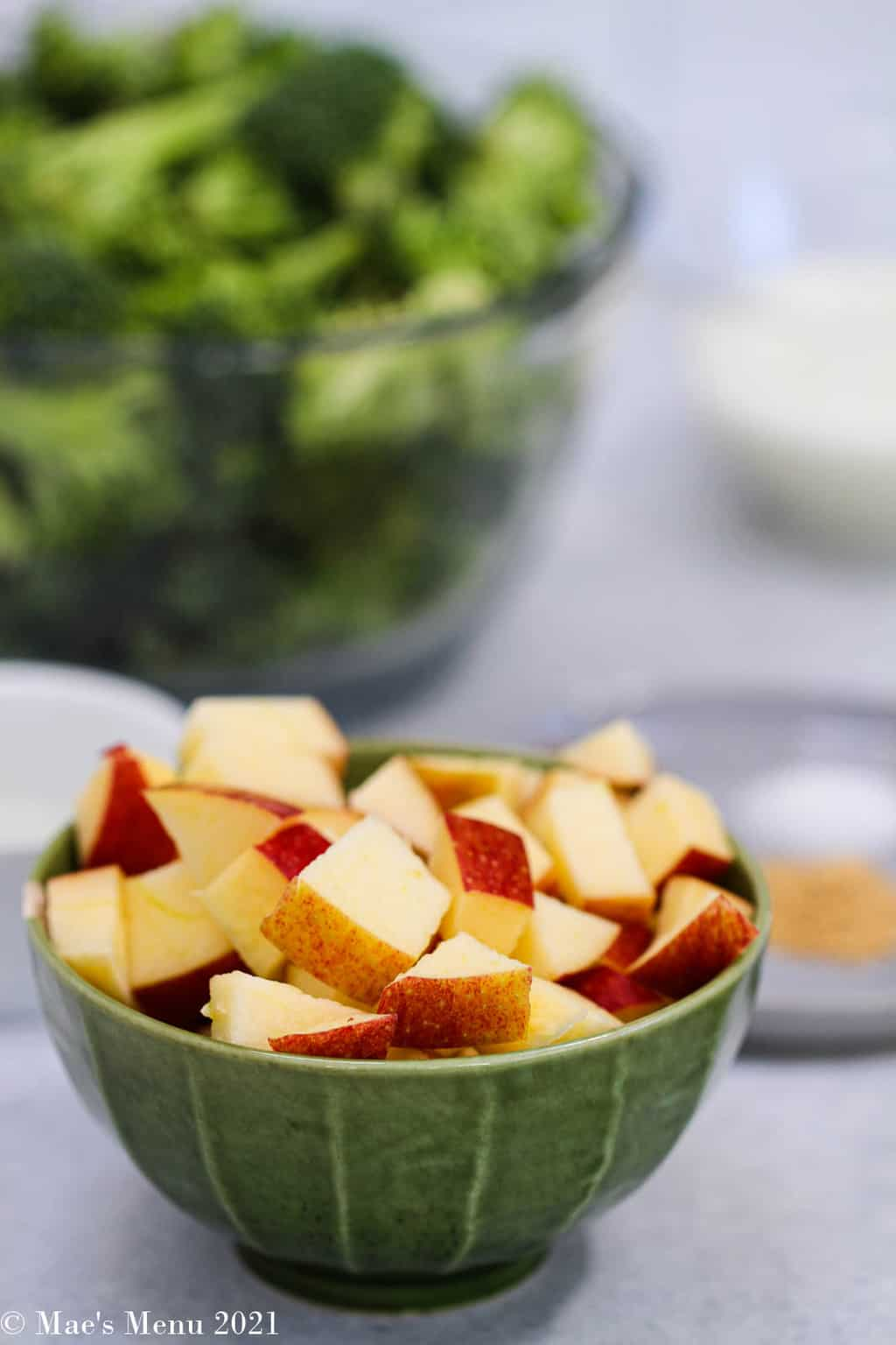 a small cup of chopped apple in front of the rest of the ingredients
