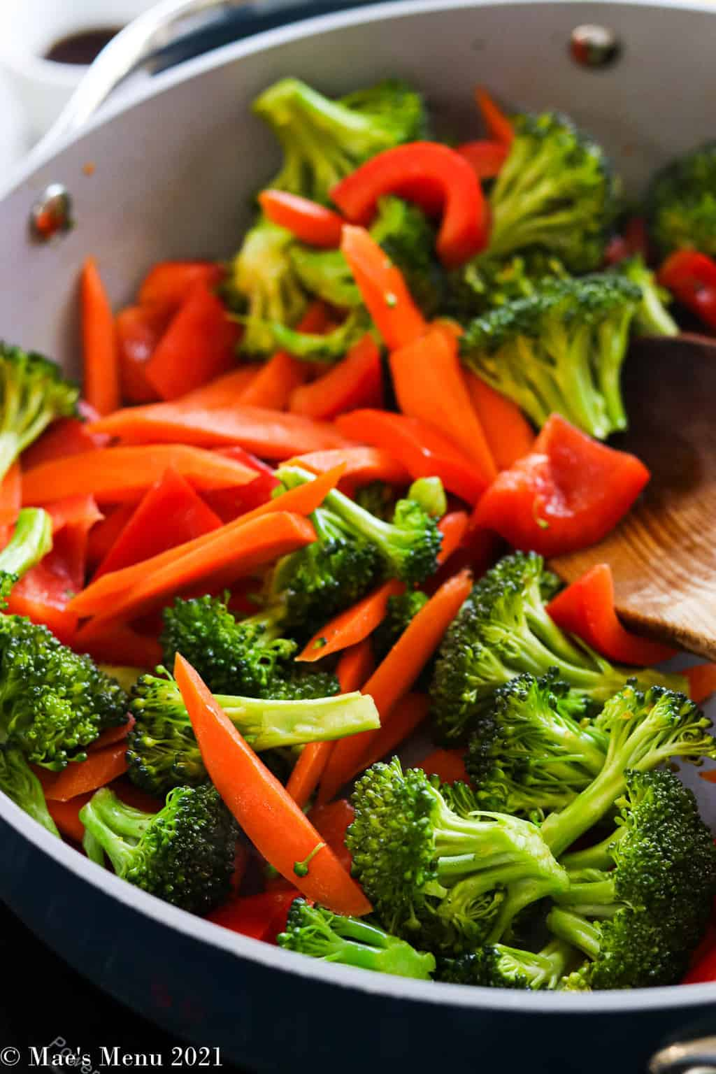 sauteing veggies in a pan
