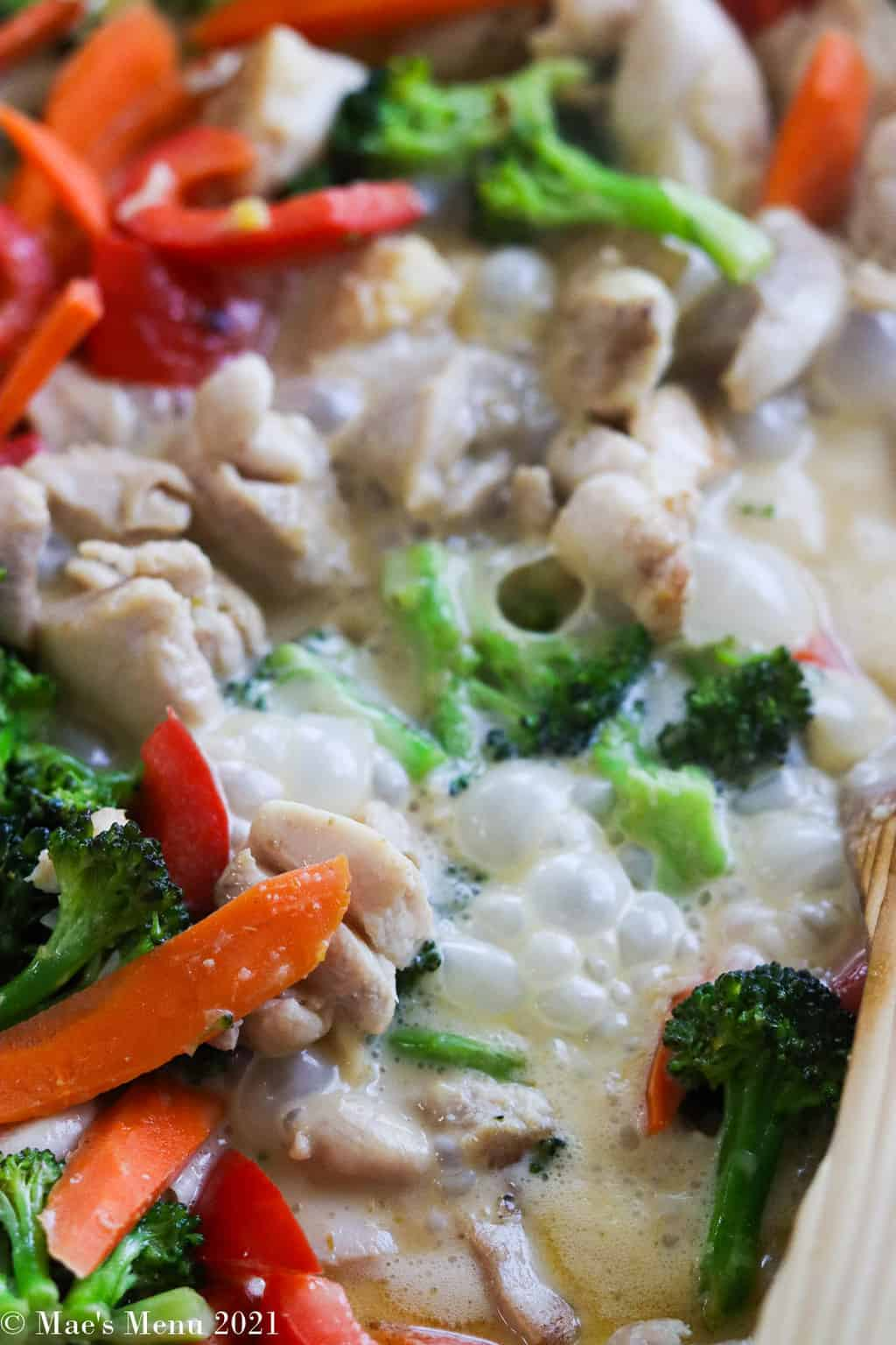 Simmering the chicken and veggies in the coconut milk