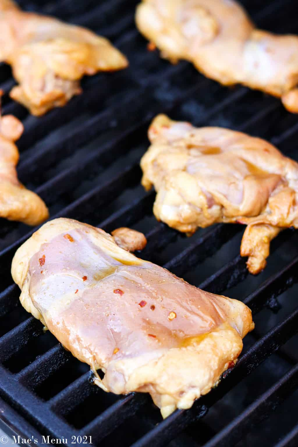 The chicken on the grill