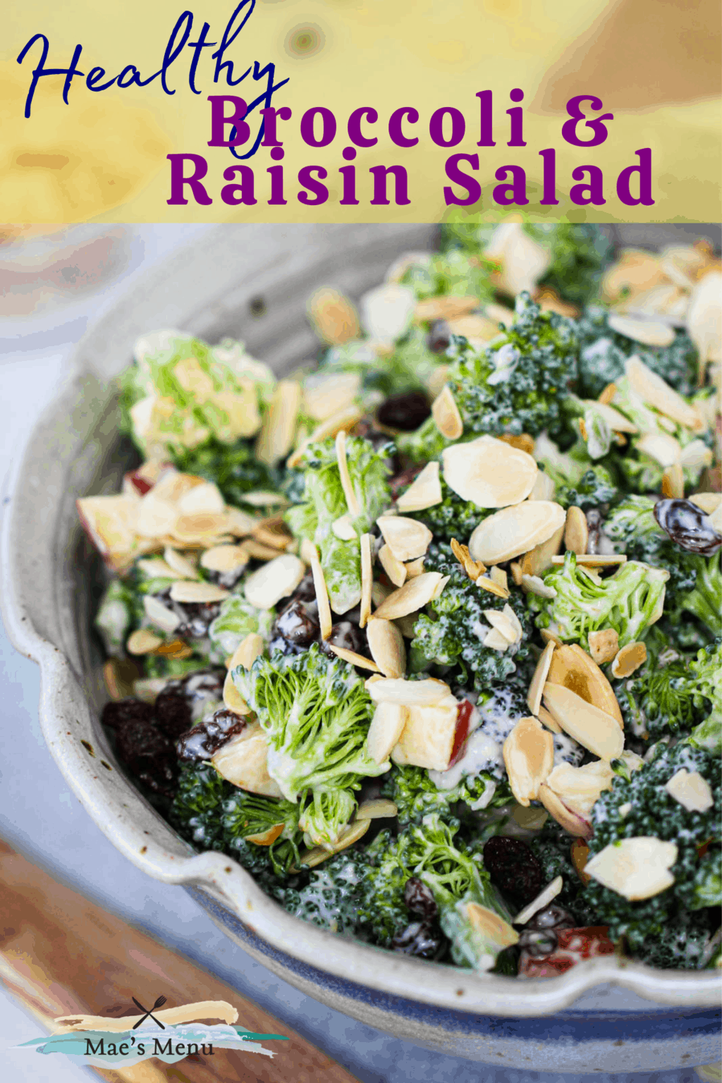 A pinterest pin for broccoli raisin salad with An up-close overhead shot of a bowl of the salad