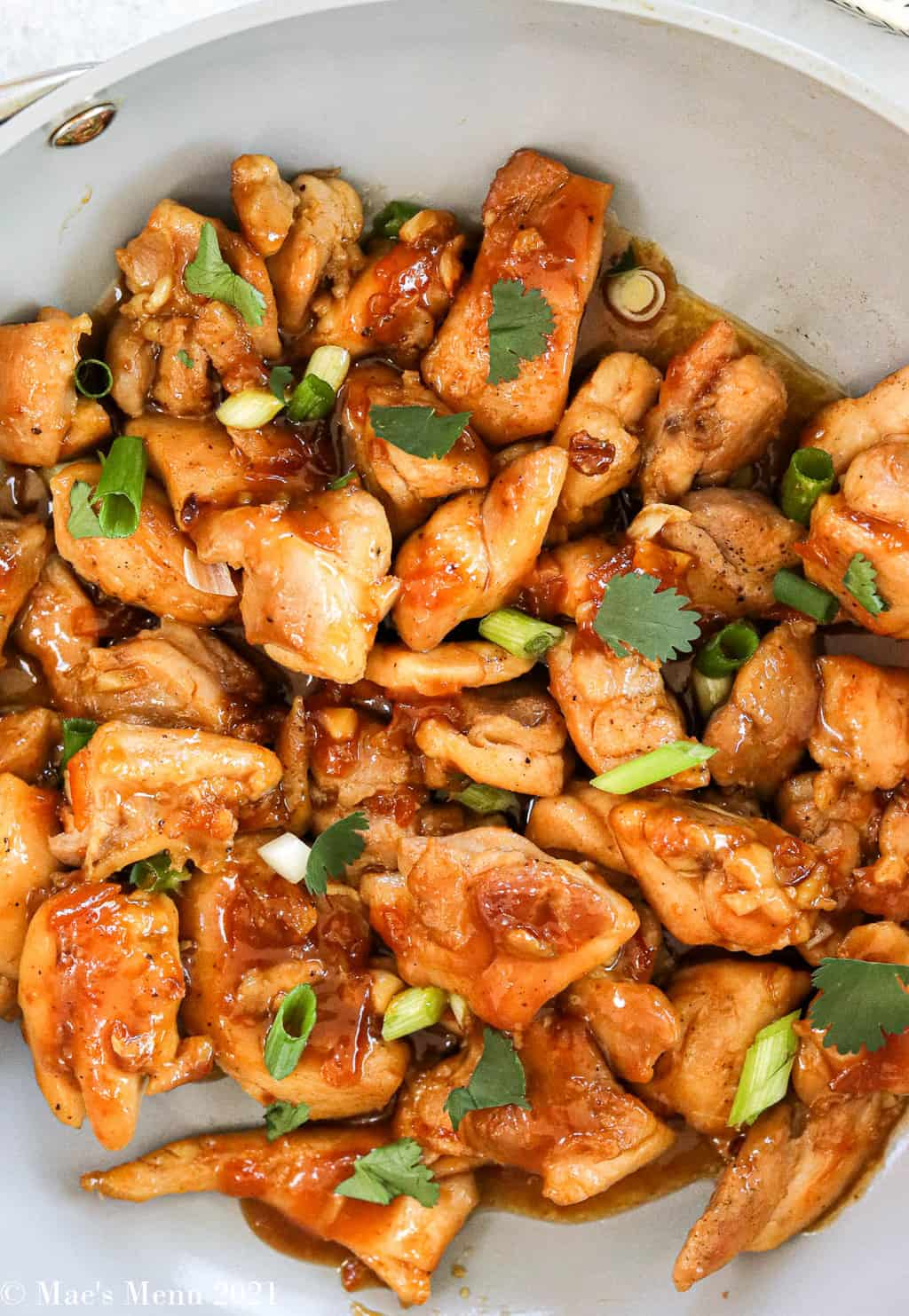 An up-close overhead shot of a pan of healthy orange chicken