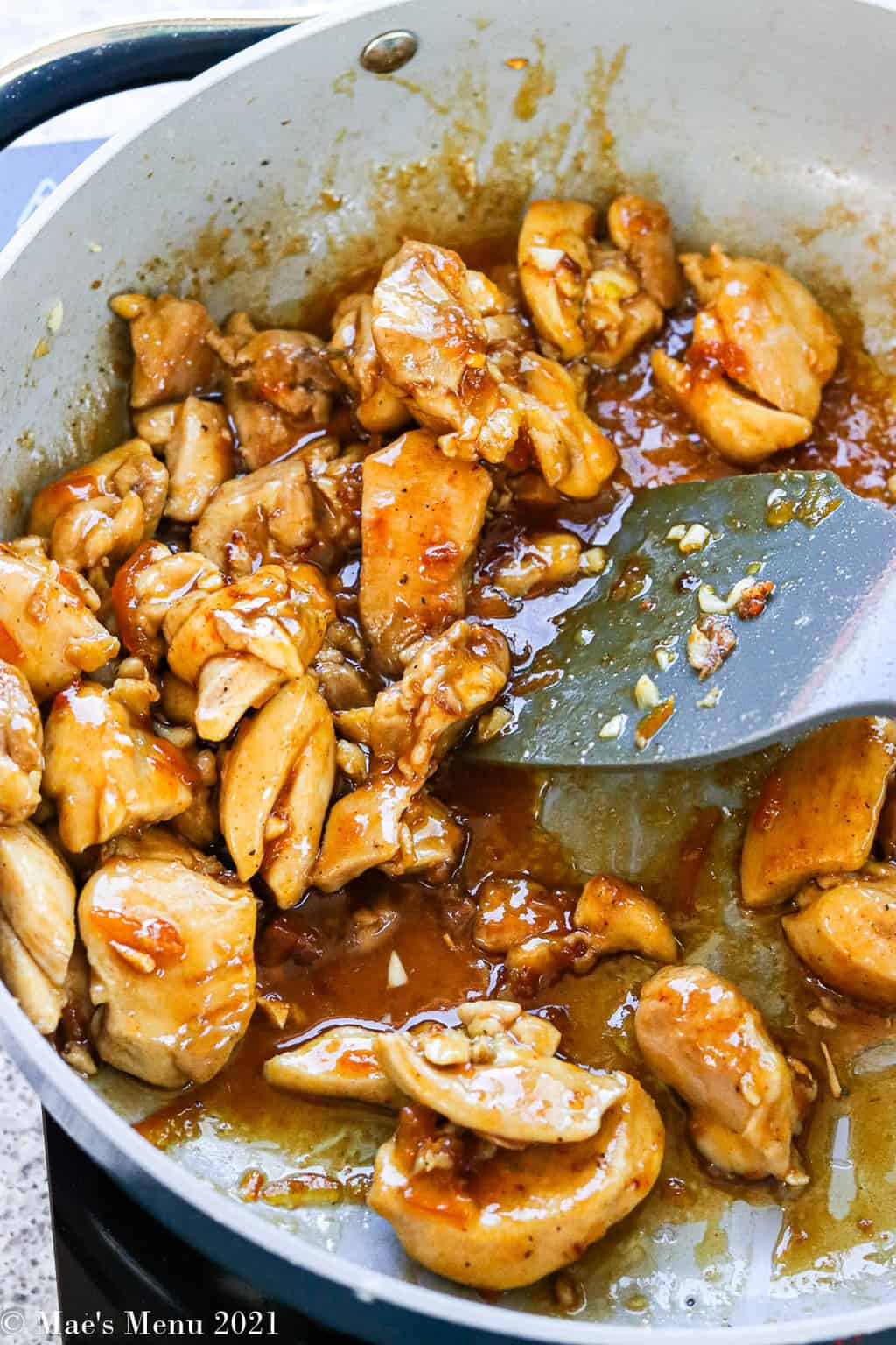 A large saute pan of healthy orange chicken