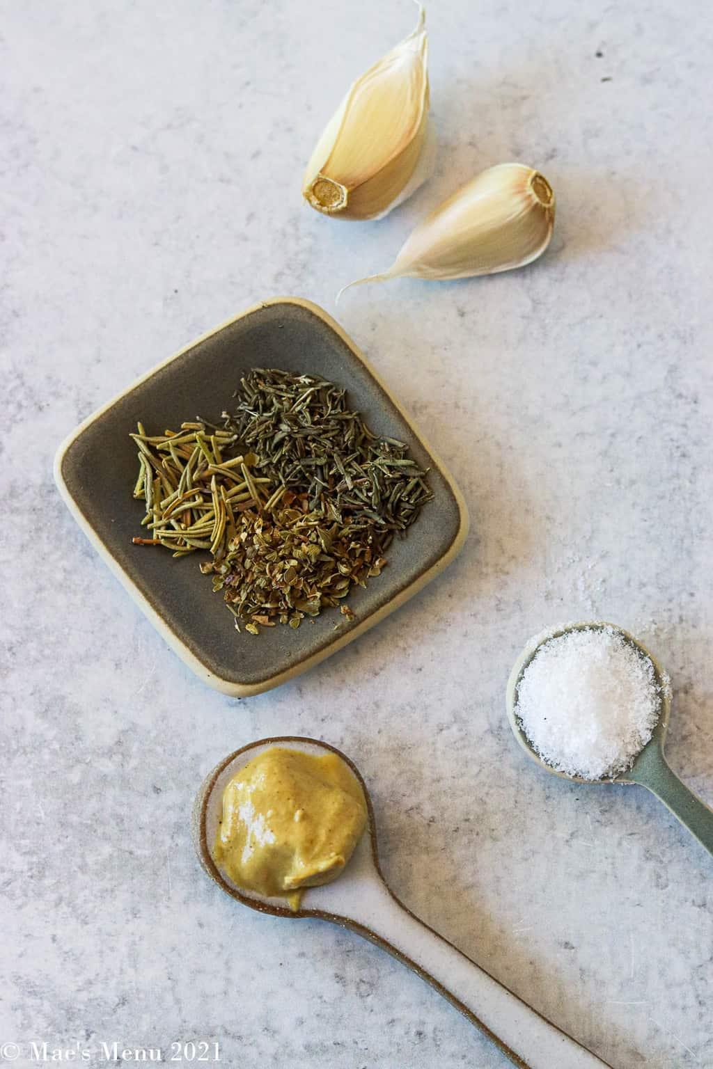 Garlic cloves, dried herbs, salt, and Dijon mustard