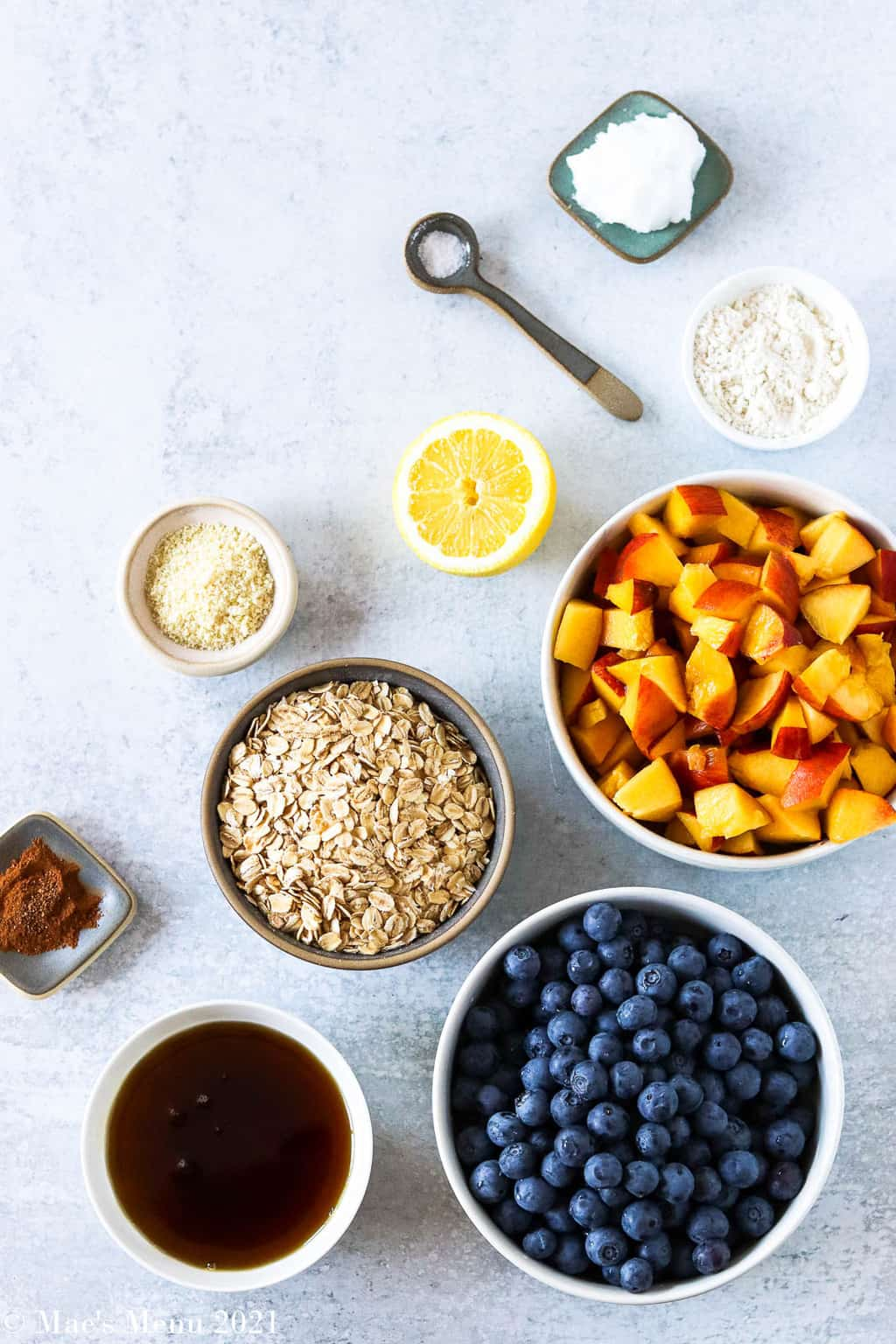 An overhead shot of all the ingredients for the blueberry peach crisp