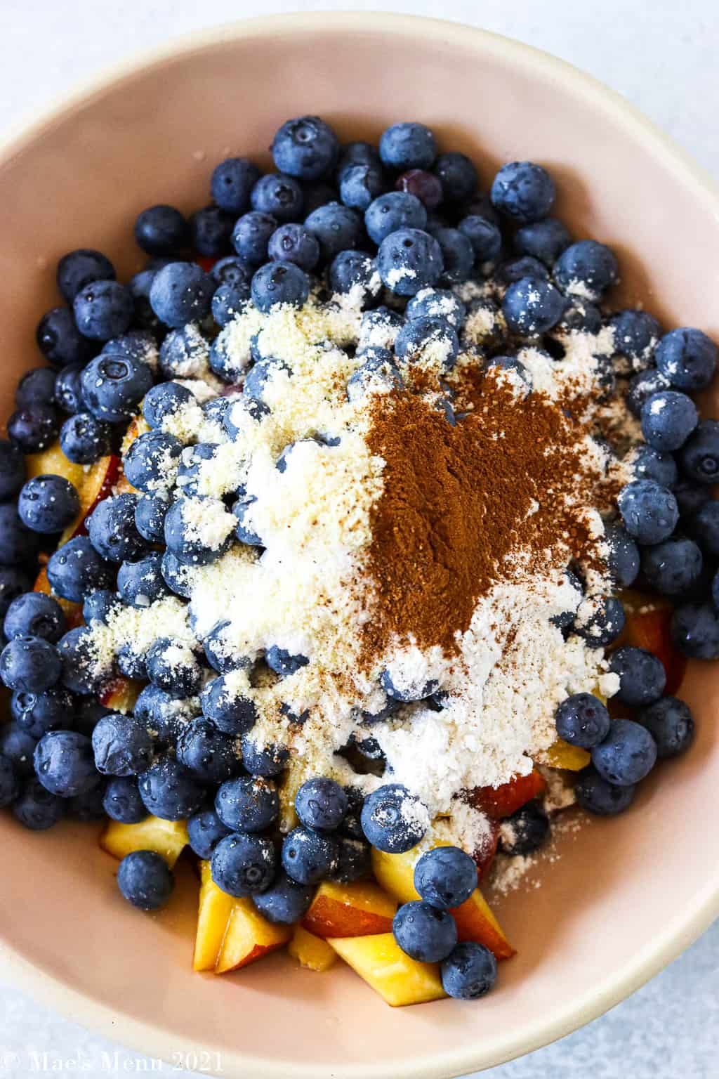 Blueberries and peaches covered with flour and spices
