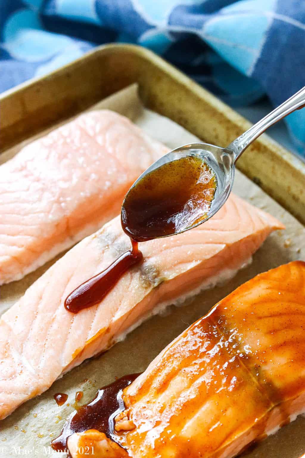 Drizzling brown sugar bourbon glaze over the salmon