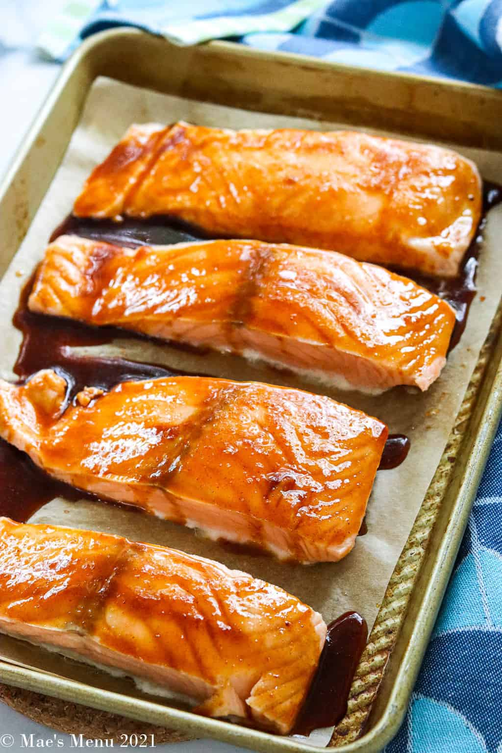 Salmon fillets spread with bourbon glaze before baking