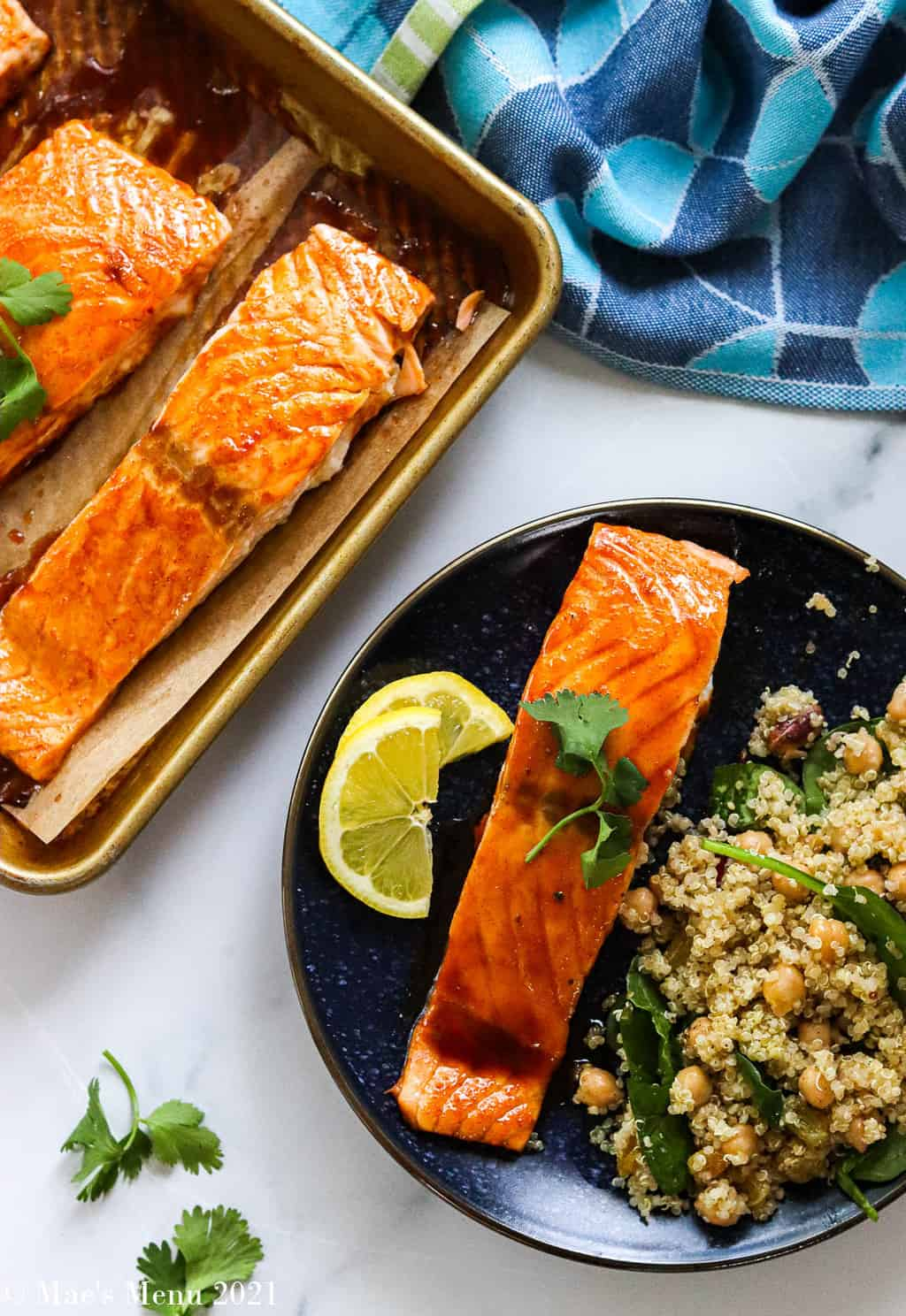An overhead shot of a pan of bourbon salmon next to a small dish of the salmon