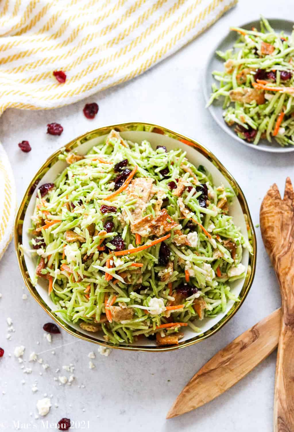 A bowl of broccoli slaw next to a small serving plate of it