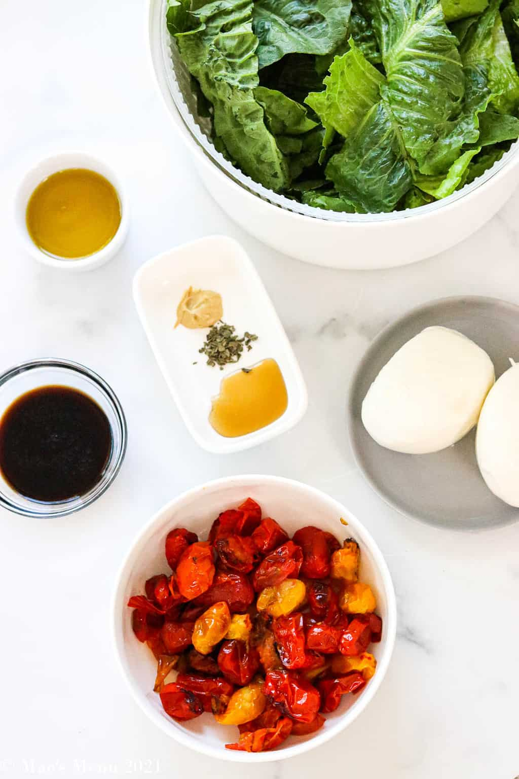 An overhead shot of the ingredients for this burrata salad with roast tomatoes