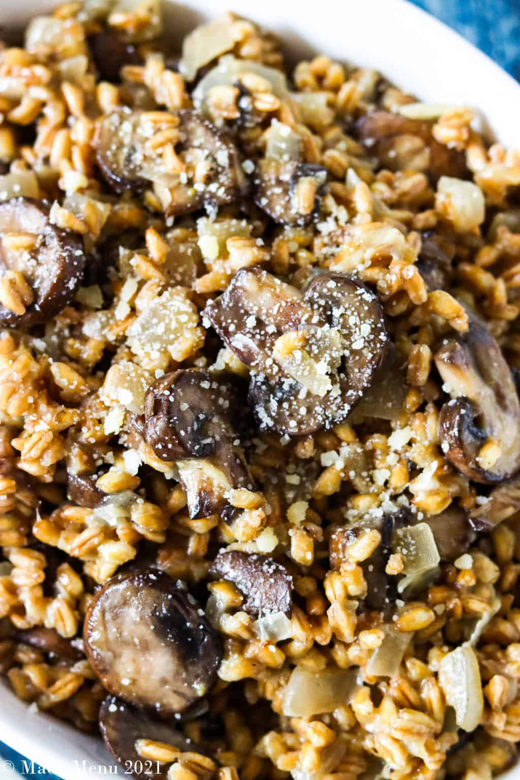 an up-close overhead shot of a bowl of mushroom farro risotto