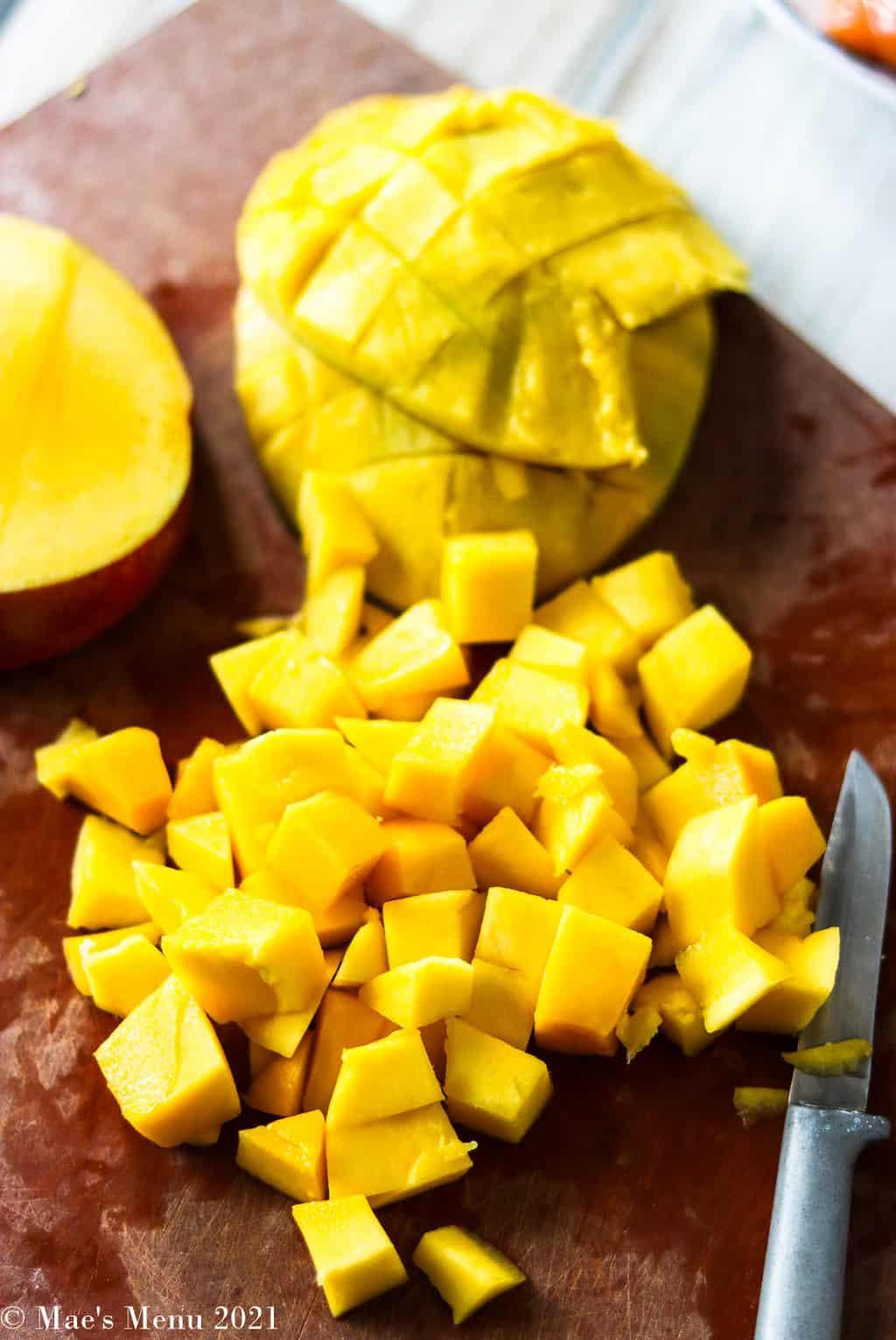 Diced mango on a cutting board