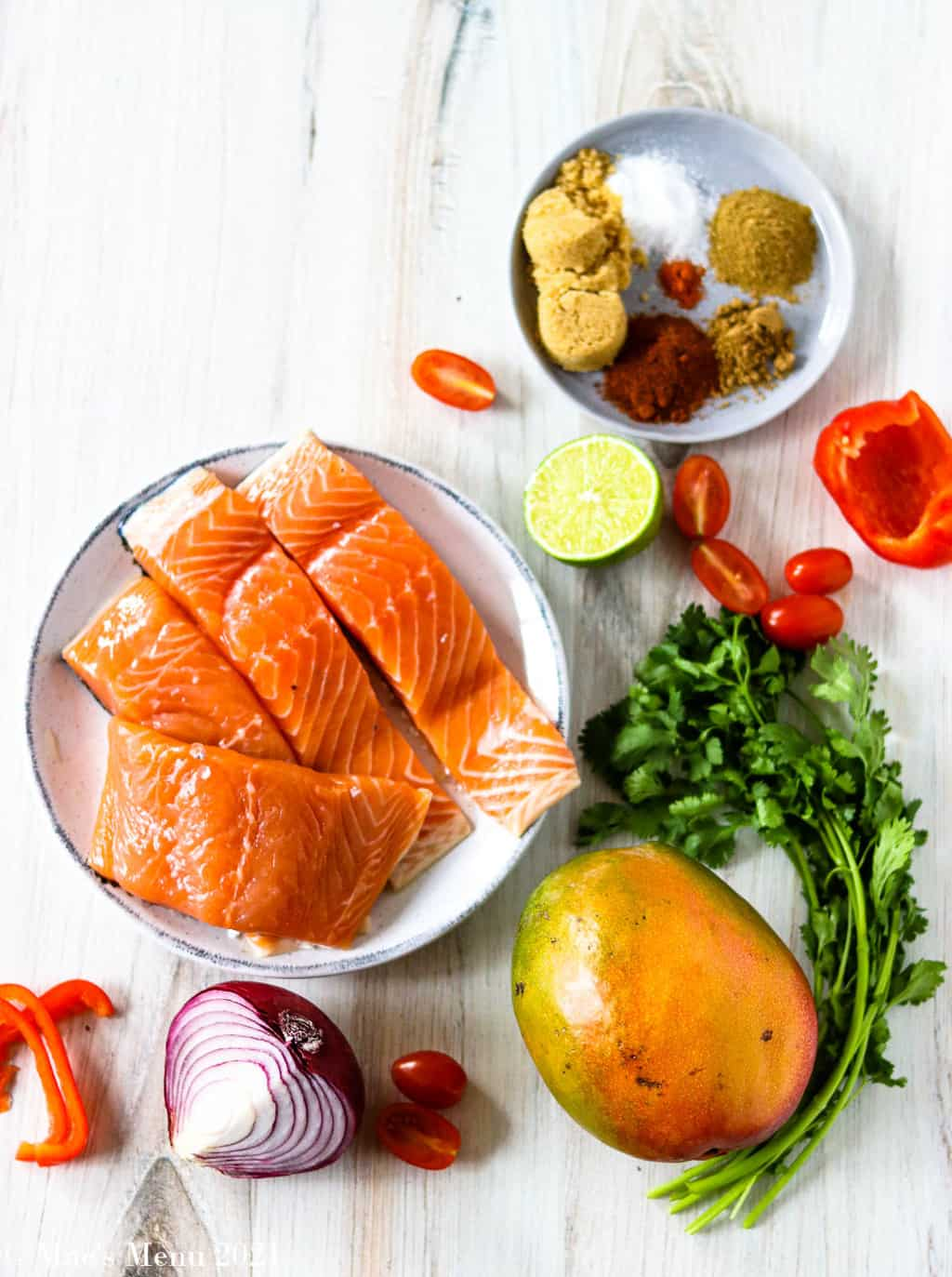 spicy brown sugar salmon ingredients -- salmon, mango, red onon, red pepper, spices, and lime