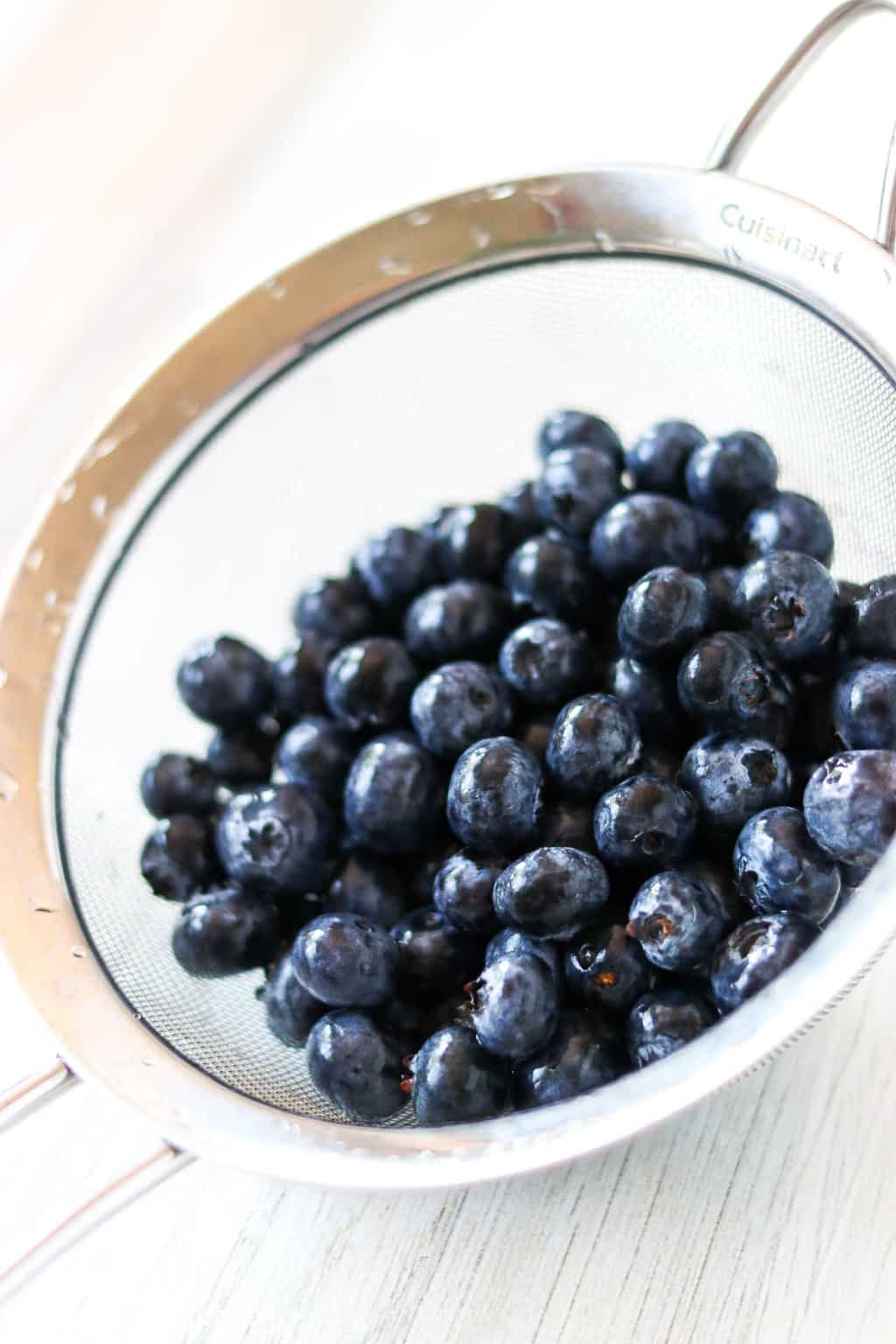 A strainer basket of blueberries