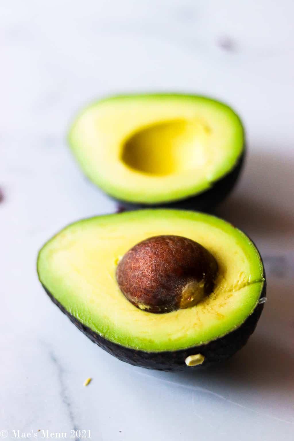 an up-close shot of a halved avocado
