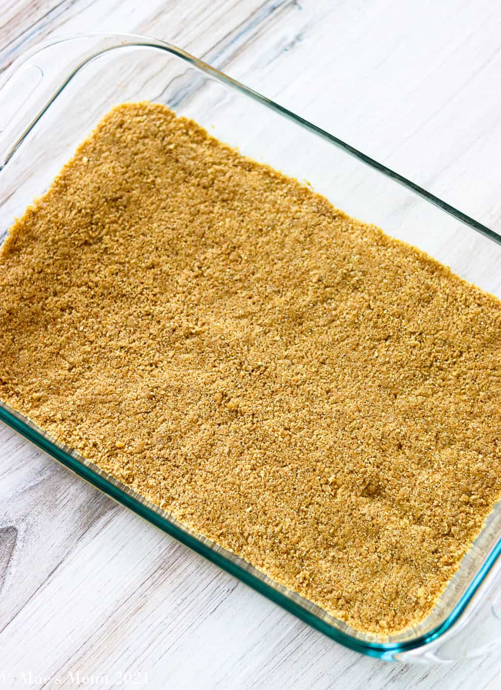Graham cracker crust pressed into a baking pan