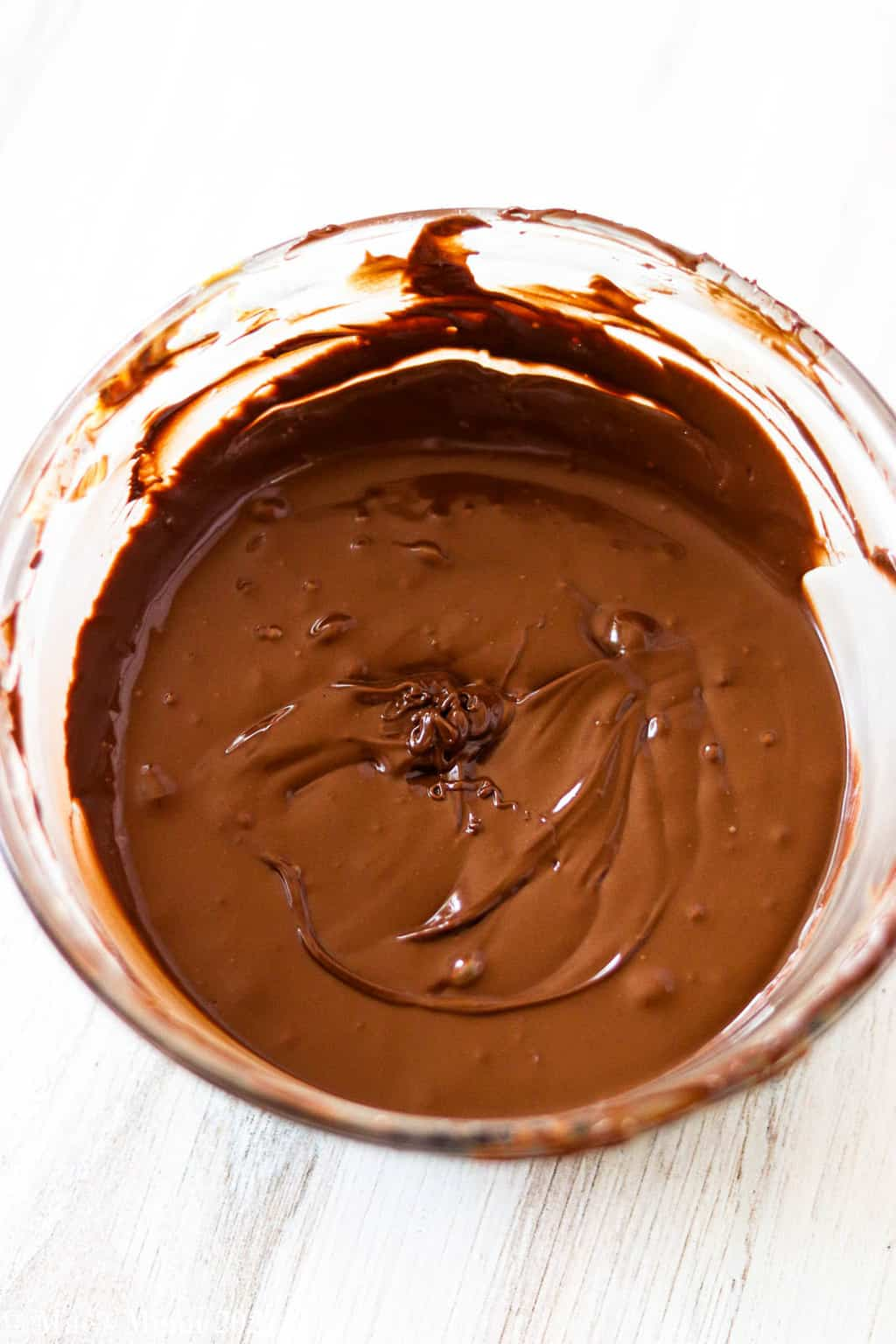 A bowl of melted chocolate and peanut butter