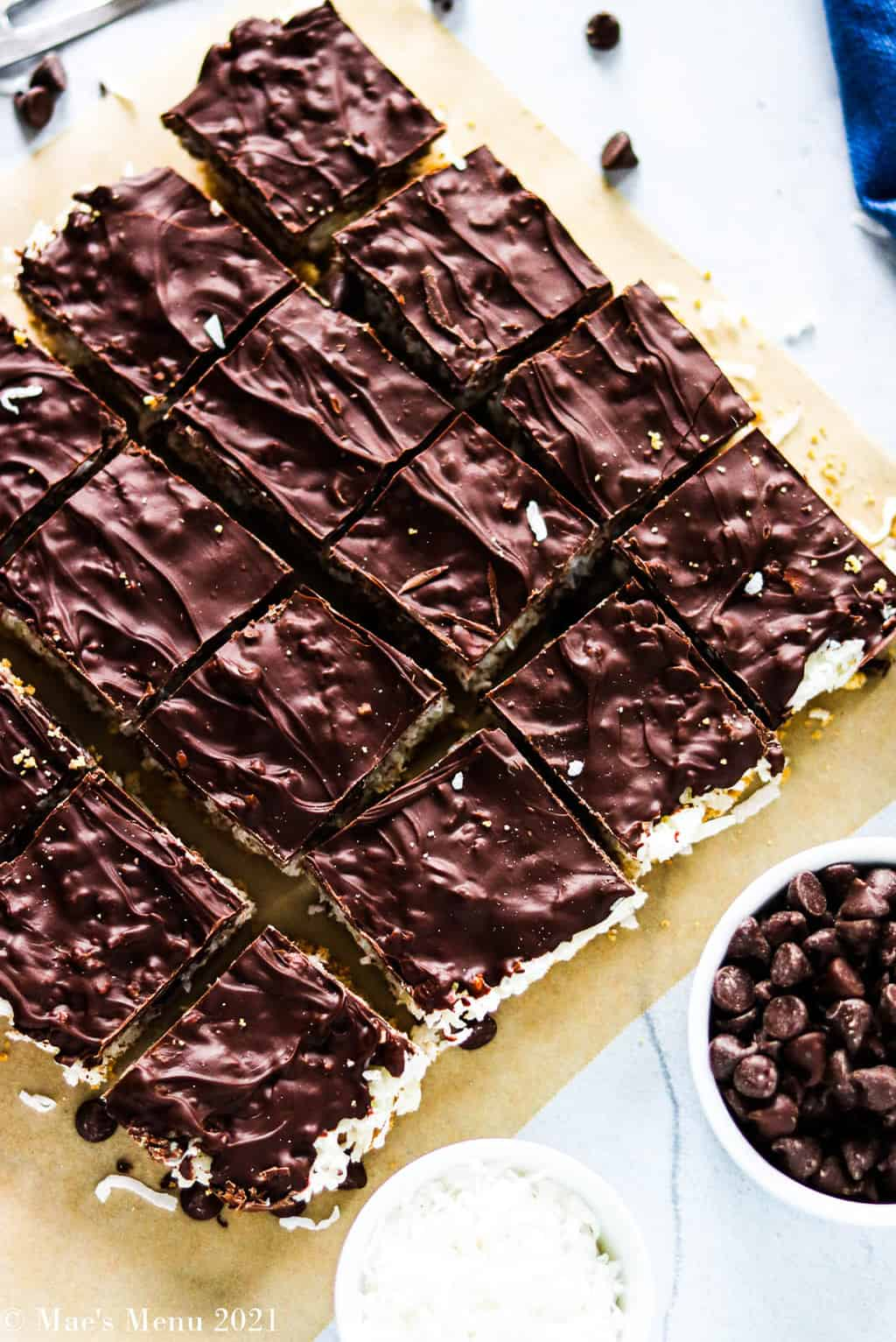 An overehead shot of chocolate coconut bars cut into pieces
