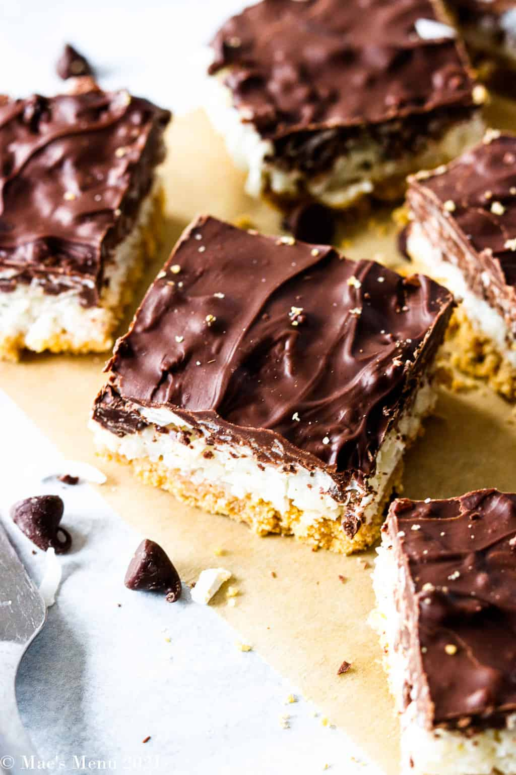 An up-close shot of a chocolate coconut bar on a counter