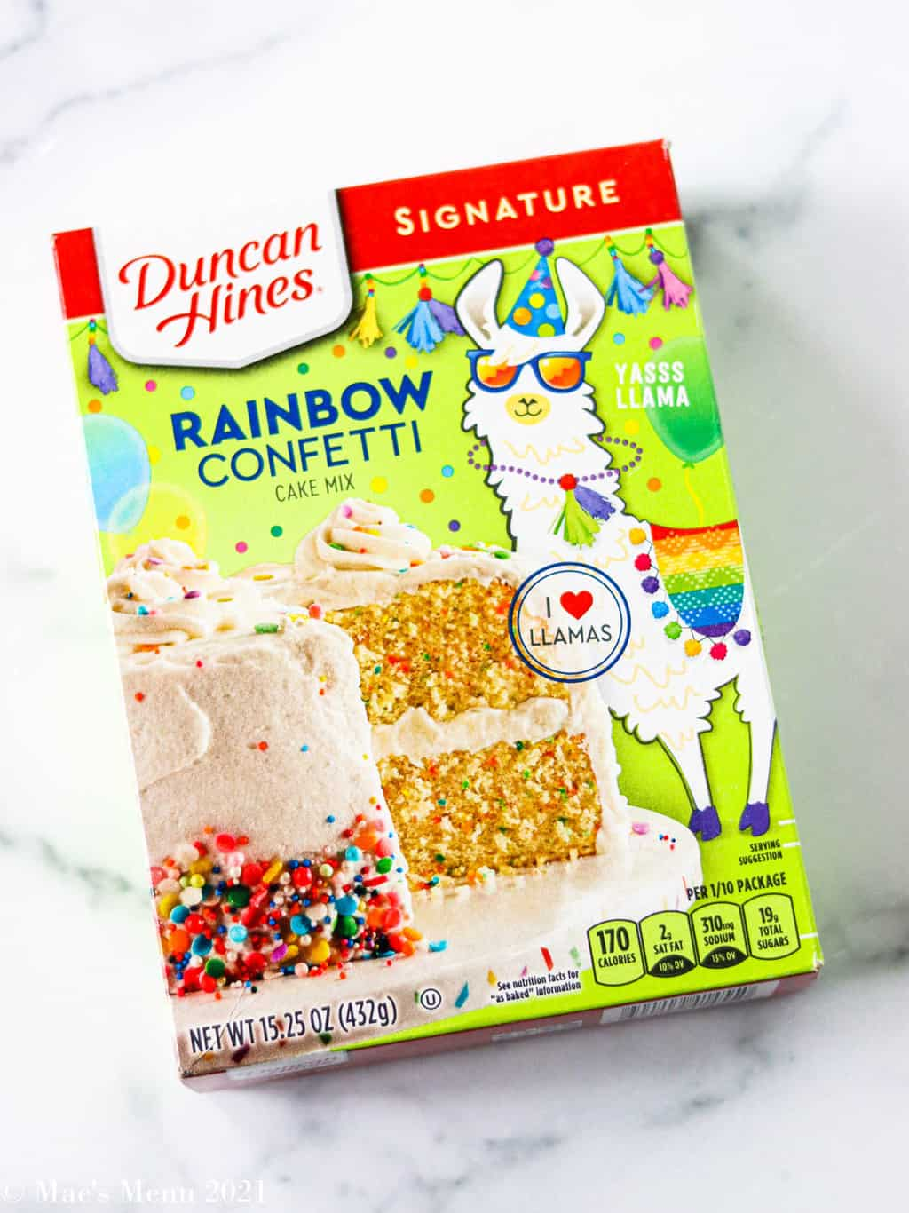 A box of Duncan Hines Rainbow confetti cake mix with a llama on the front of it