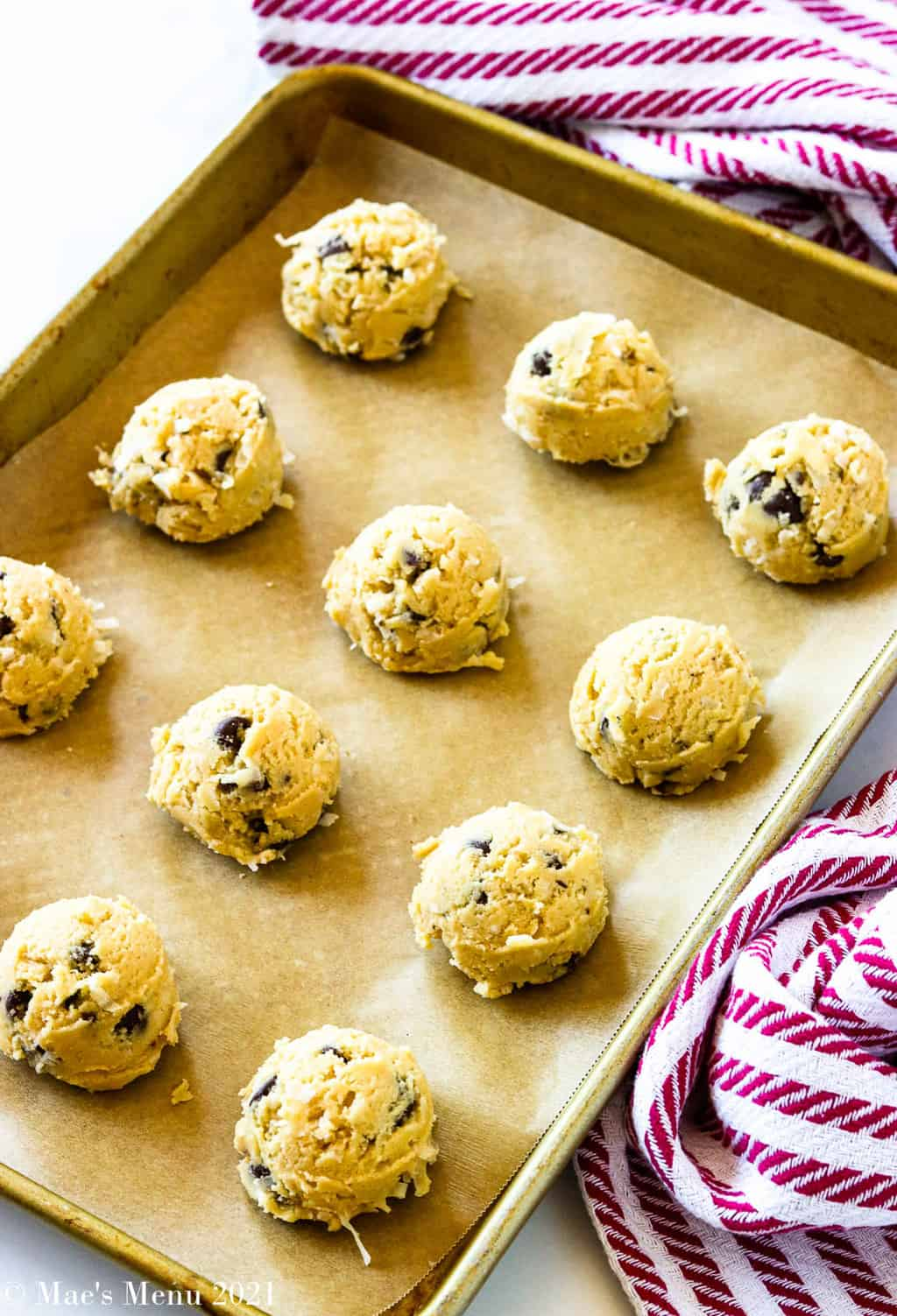 Chocolate chip coconut cookies scooped onto a baking dish