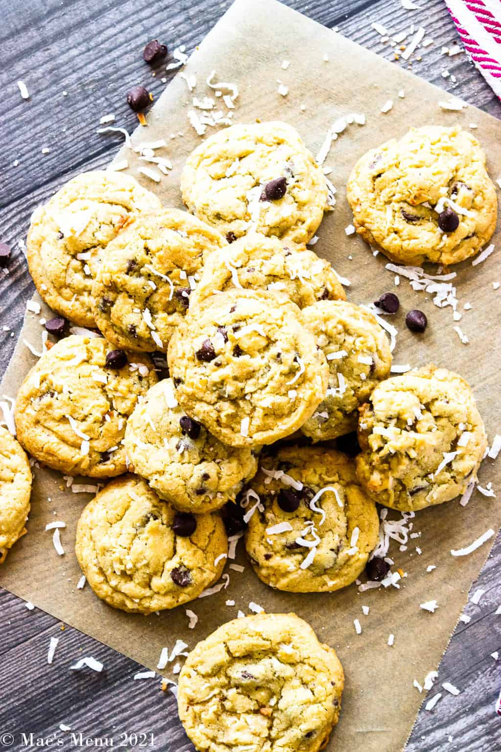 An overhead shot of a pile of coconut chocolate chip cookies