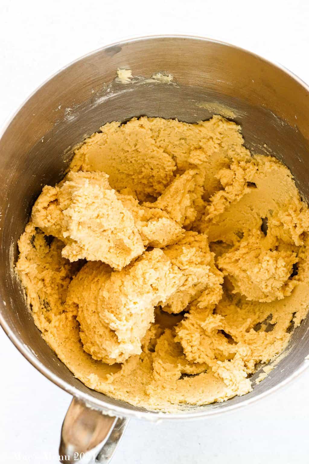 Cream cheese spritz cookies dough in a mixing bowl