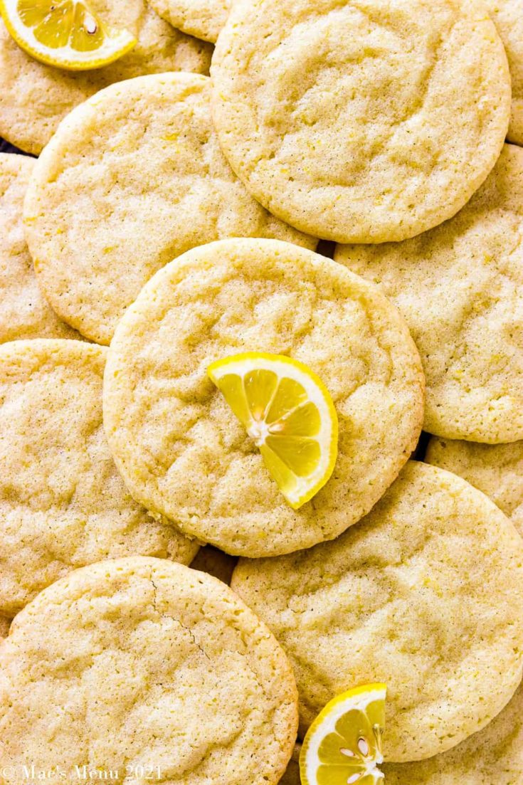 An overhead shot of lemon sugar cookies sacked on each other