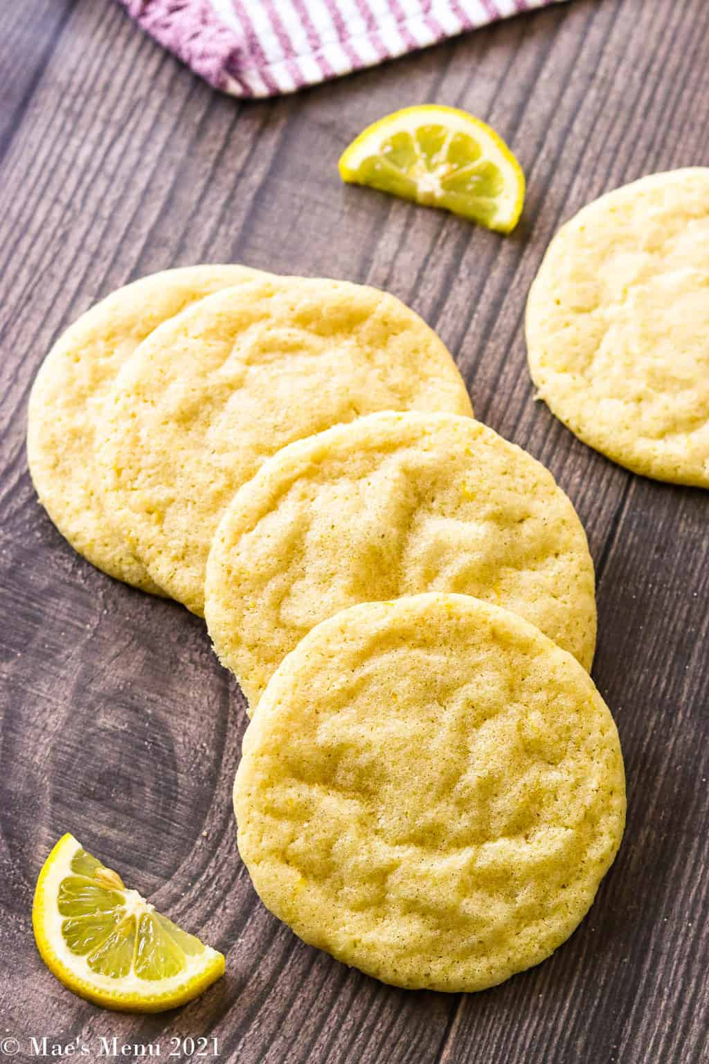 Lemon sugar cookies stacked on each other on a crescent shape