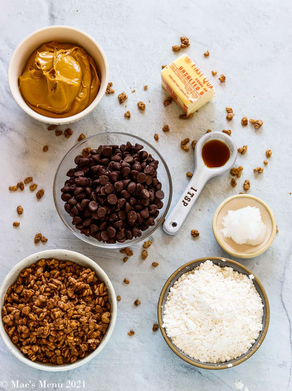 All the ingredients for peanut butter bon bons: peanut butter, chocolate chips, powdered sugar, coconut oil, vanilla, butter, cocoa krispies