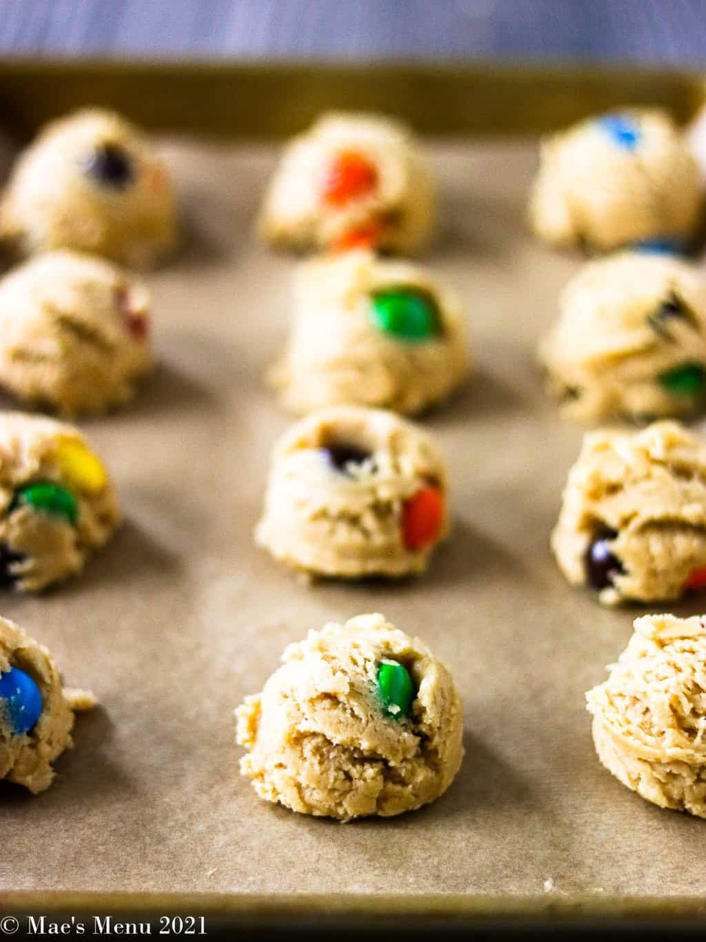 A side shot of scoops of peanut butter M&M cookie dough